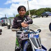 Motocross competitor Jerisha Guzman, 9,  before her Monster Energy 2018 Guam Motocross Championship race at Guam International Raceway in Yigo, Sept. 16, 2016.