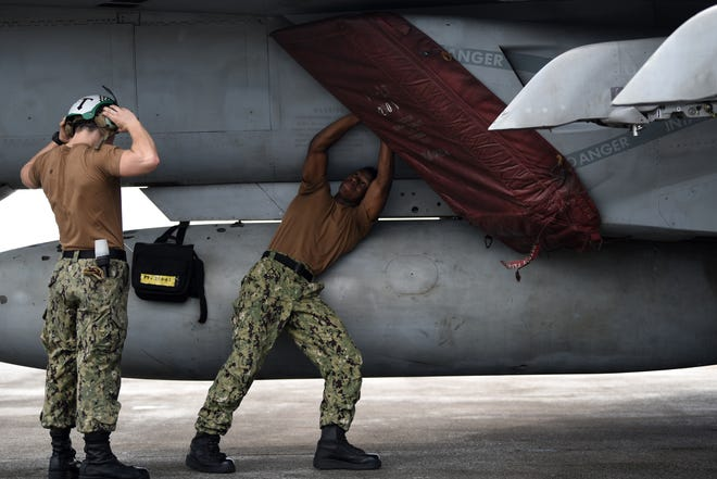 U.S. Navy sailors conduct post-flight checks on an F/A-18E Super Hornet Saturday at Andersen Air Force Base. The aircraft is set to participate in exercise Valiant Shield 2018. Valiant Shield is a biennial, U.S. only, field training exercise with a focus on integration of joint training among U.S. forces.