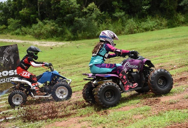 Mini ATV competitor Camerish Chaco gets an early lead on Gabriel Calvo during the Monster Energy 2018 Guam Motocross Championship at Guam International Raceway on Sept. 16, 2018. Chaco won the overall title in the Kids Open Mini ATV.