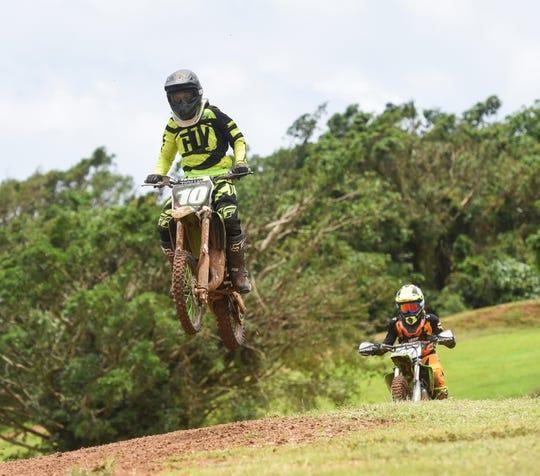 Jerren Nauta (10) and Wyett-Ken Santos (22) compete during the Monster Energy 2018 Guam Motocross Championship at Guam International Raceway in Yigo, Sept. 16, 2016.