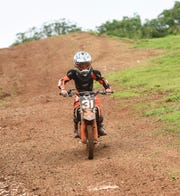 Richard Wenden storms down a hill a during the Monster Energy 2018 Guam Motocross Championship at Guam International Raceway in Yigo, Sept. 16. Wenden swept both heats and claimed the class championship in the 65cc Kids Minibike.