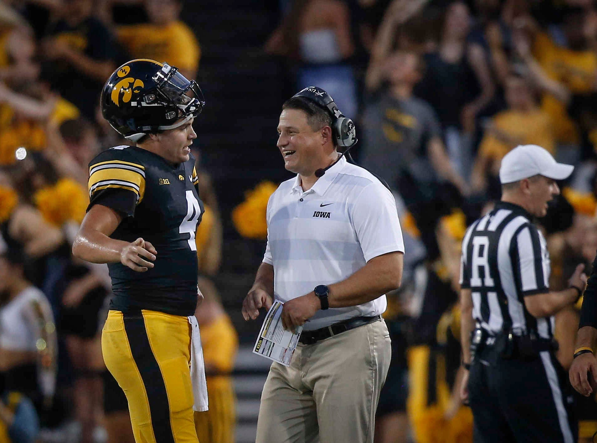 Iowa quarterback Nate Stanley speaks with offensive coordinator Brian Ferentz during a time out against Northern Iowa on Saturday, Sept. 15, 2018, at Kinnick Stadium in Iowa City.