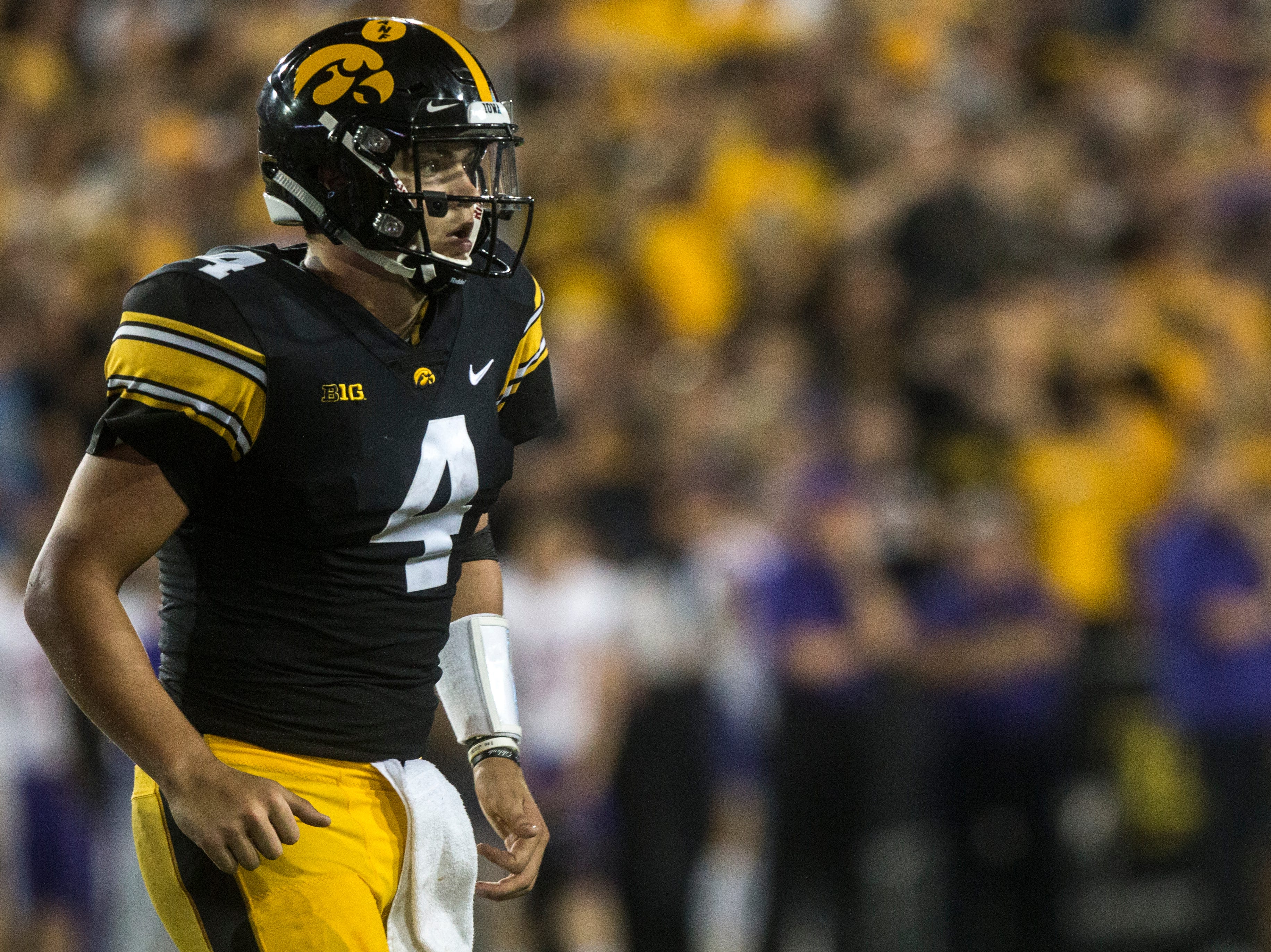 Iowa quarterback Nate Stanley (4) runs to the sideline during an NCAA football game on Saturday, Sept. 15, 2018, at Kinnick Stadium in Iowa City.