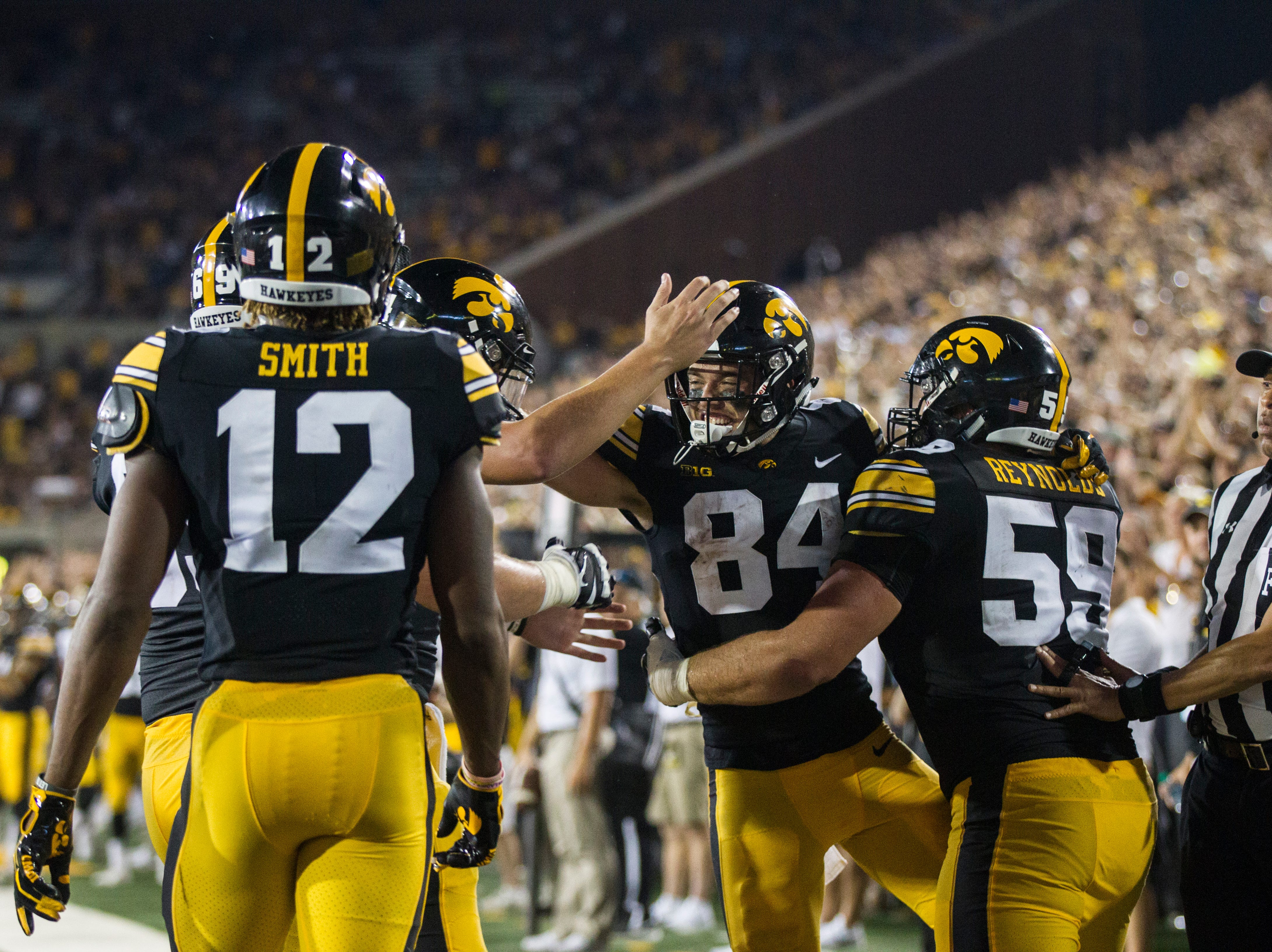 Iowa wide receiver Nick Easley (84) celebrates with teammates after catching a touchdown pass during an NCAA football game on Saturday, Sept. 15, 2018, at Kinnick Stadium in Iowa City.