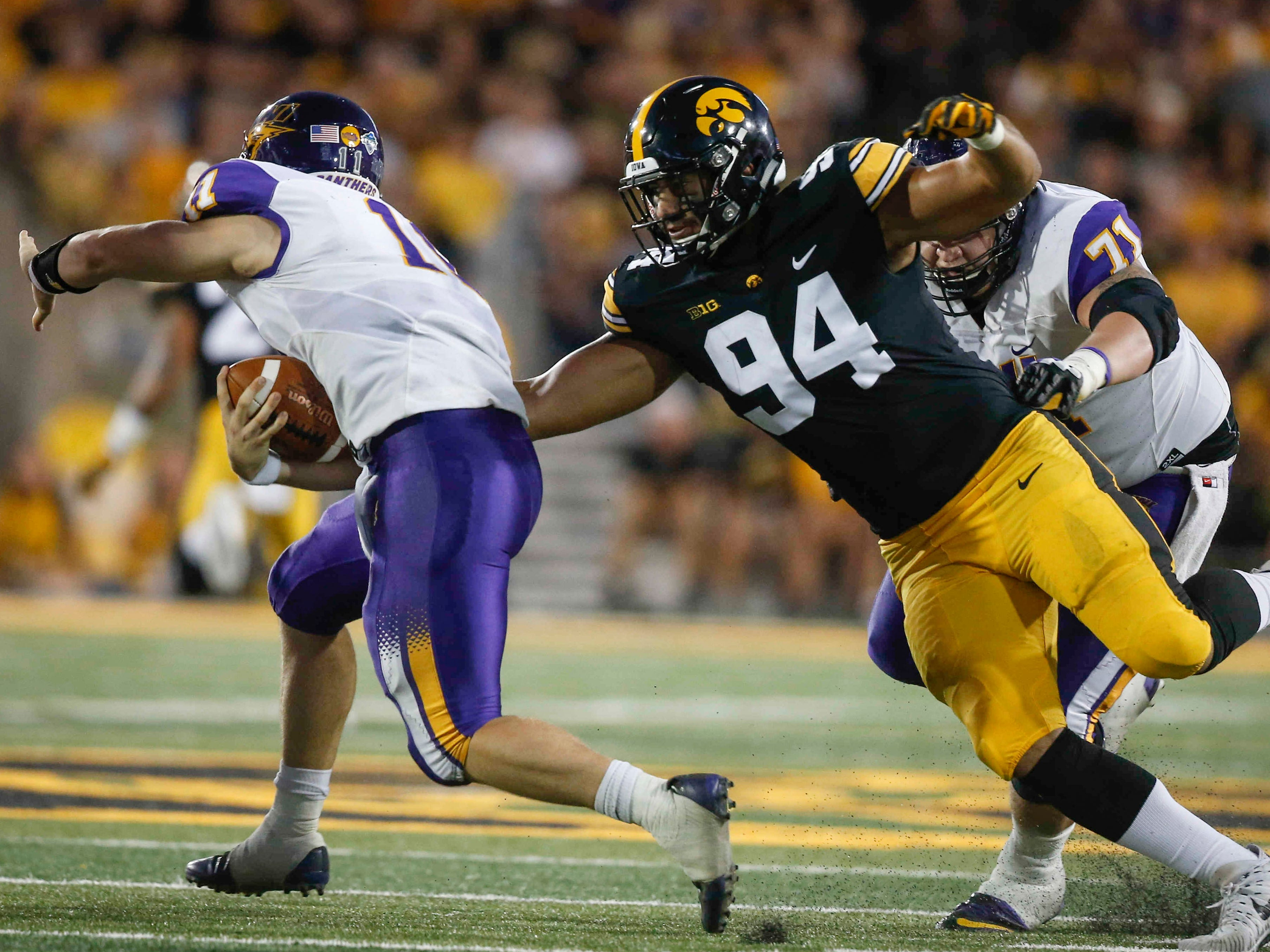 Iowa right end A.J. Epenesa catches Northern Iowa quarterback Colton Howell on Saturday, Sept. 15, 2018, at Kinnick Stadium in Iowa City.