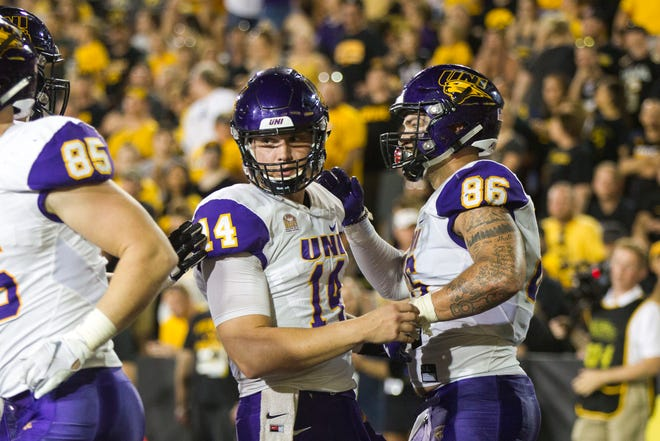 Northern Iowa tight end Briley Moore (86) celebrates with Northern Iowa quarterback Eli Dunne (14) after catching a touchdown pass during an NCAA football game on Saturday, Sept. 15, 2018, at Kinnick Stadium in Iowa City.