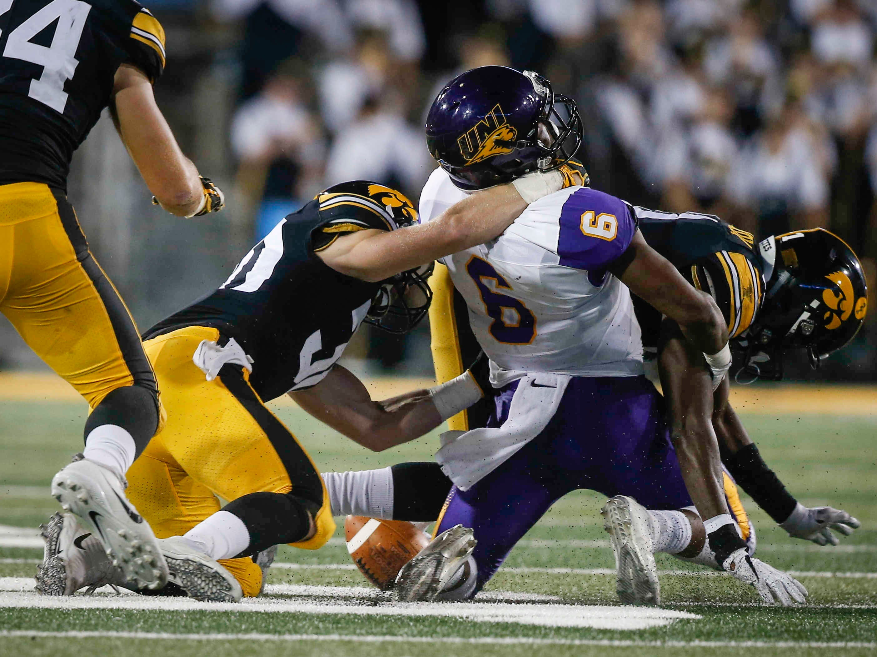 Iowa safety Jake Gervase hits Northern Iowa receiver Terrell Carey hard enough to force a fumble on Saturday, Sept. 15, 2018, at Kinnick Stadium in Iowa City.