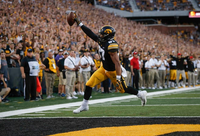 Iowa junior tight end Noah Fant celebrates in the end zone after scoring a touchdown against Northern Iowa in the first quarter on Saturday, Sept. 15, 2018, at Kinnick Stadium in Iowa City.