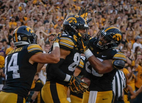 Members of the Iowa Hawkeyes football team celebrate after tight end Noah Fant scored a touchdown against Northern Iowa on Saturday, Sept. 15, 2018, at Kinnick Stadium in Iowa City.