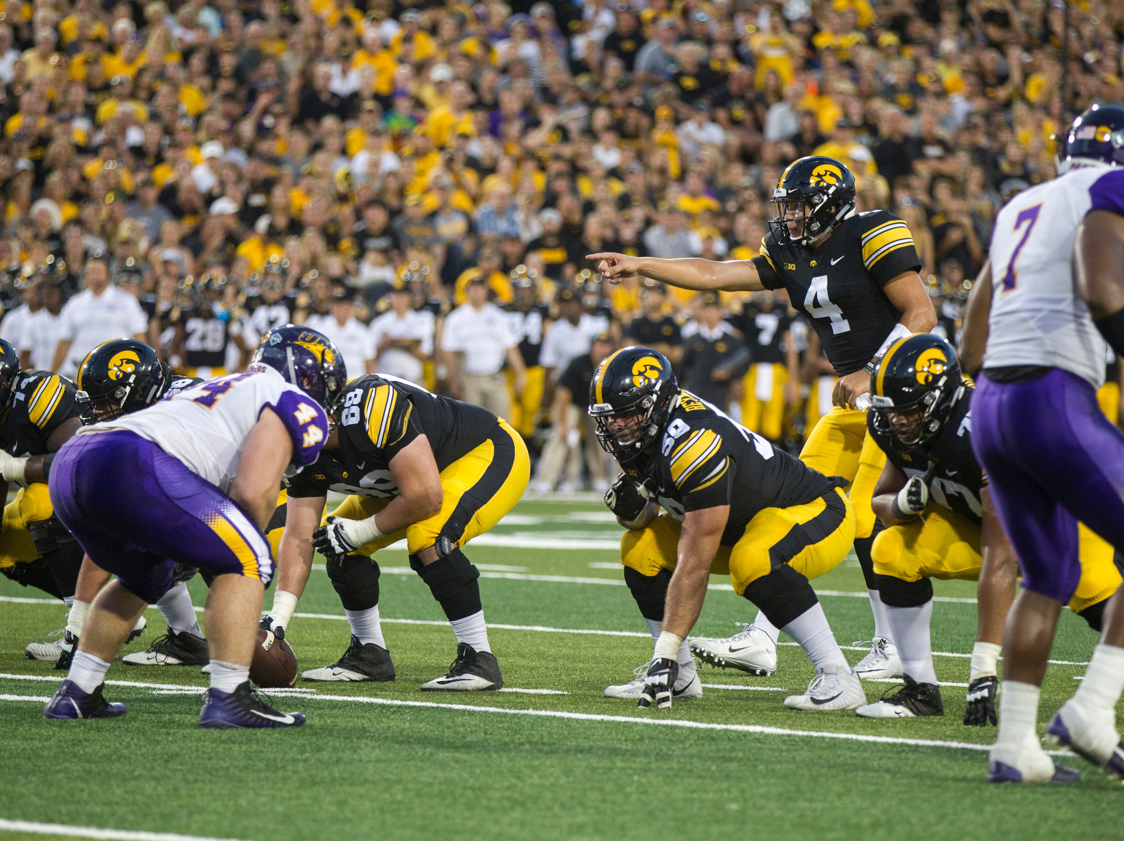 Iowa quarterback Nate Stanley (4) gestures at the line during an NCAA football game on Saturday, Sept. 15, 2018, at Kinnick Stadium in Iowa City.