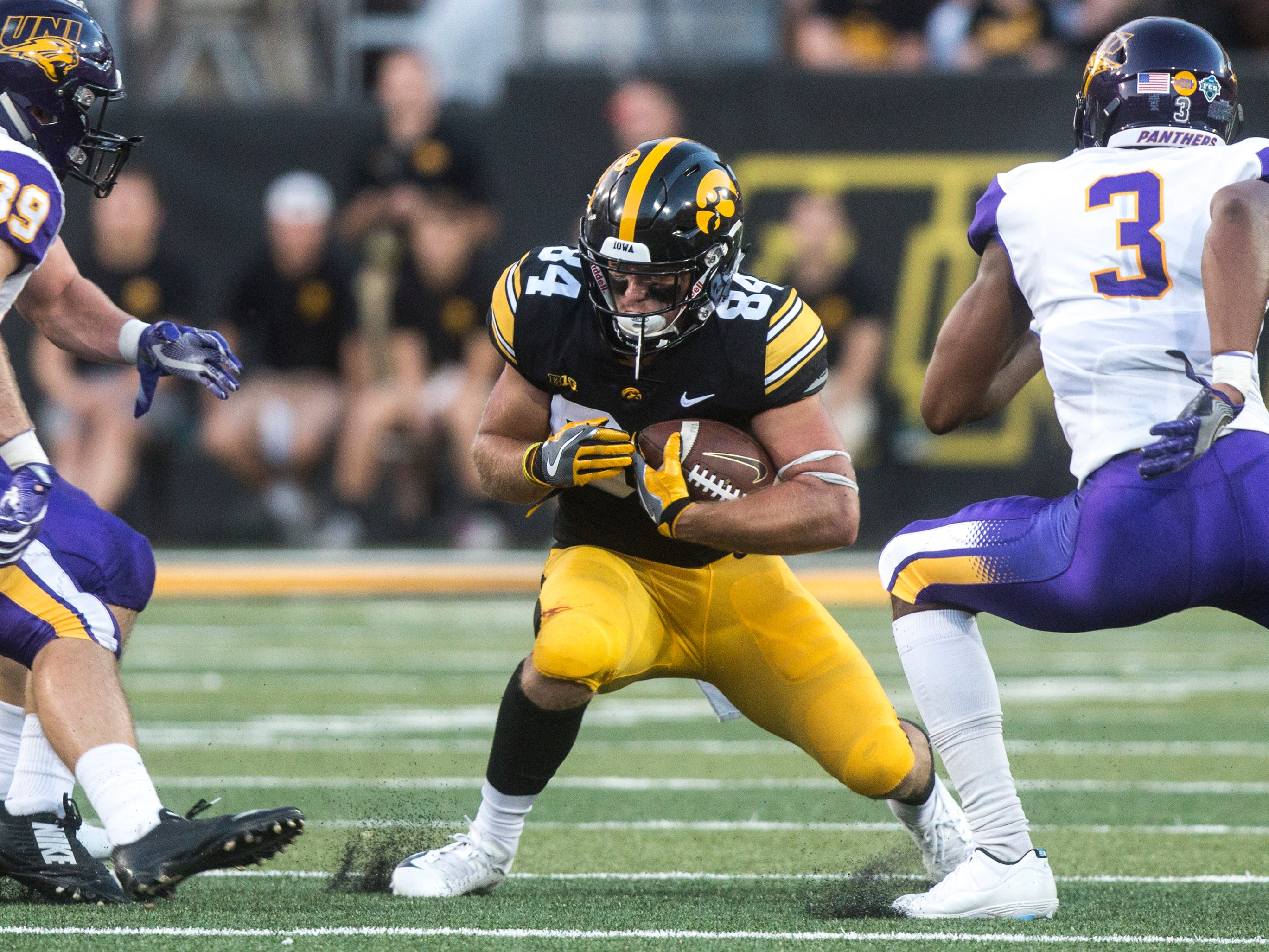 Iowa wide receiver Nick Easley (84) catches a pass while Northern Iowa defenders close in during an NCAA football game on Saturday, Sept. 15, 2018, at Kinnick Stadium in Iowa City.