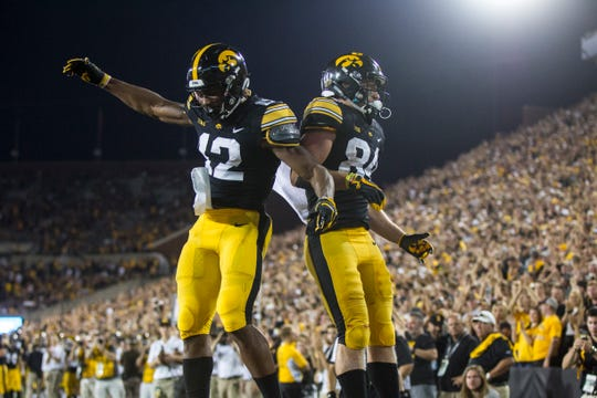 Iowa wide receiver Nick Easley (84) celebrates with Iowa wide receiver Brandon Smith (12) during an NCAA football game on Saturday, Sept. 15, 2018, at Kinnick Stadium in Iowa City.