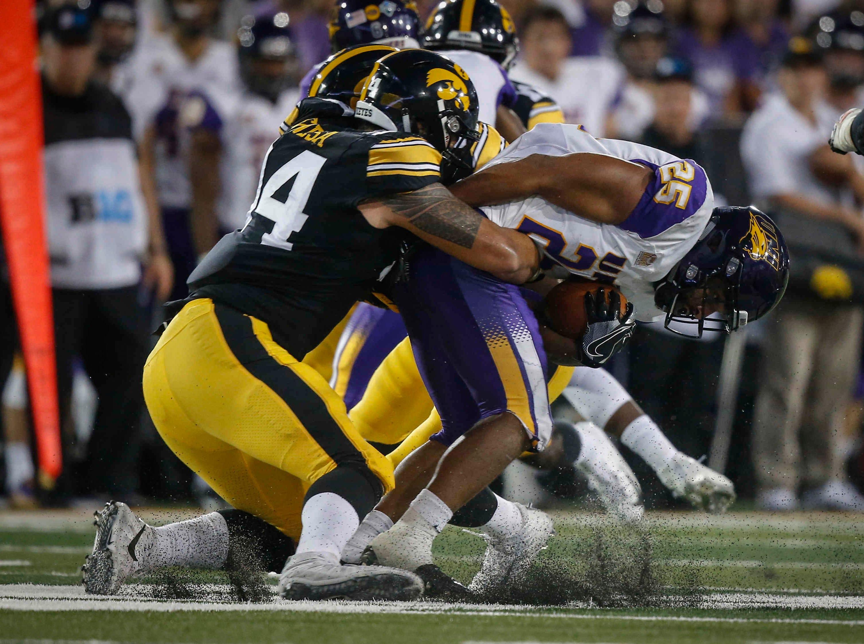 Iowa right end A.J. Epenesa tackles Northern Iowa running back Trevor Allen on Saturday, Sept. 15, 2018, at Kinnick Stadium in Iowa City.