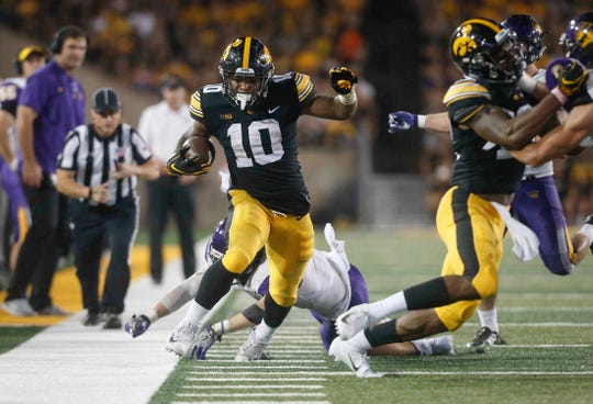 Iowa running back Mekhi Sargent tiptoes along the sideline after running the ball for a first down against Northern Iowa on Saturday, Sept. 15, 2018, at Kinnick Stadium in Iowa City.