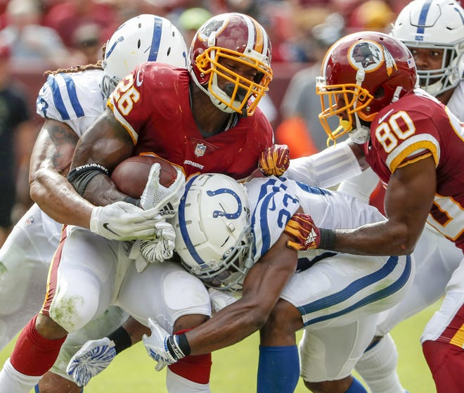 Indianapolis Colts cornerback Kenny Moore (23) hits Washington Redskins running back Adrian Peterson (26) during second half action. The Indianapolis Colts play the Washington Redskins at FedEx Field in Landover, MD., Sunday, Sept. 16, 2018. Colts won the game 21-9.