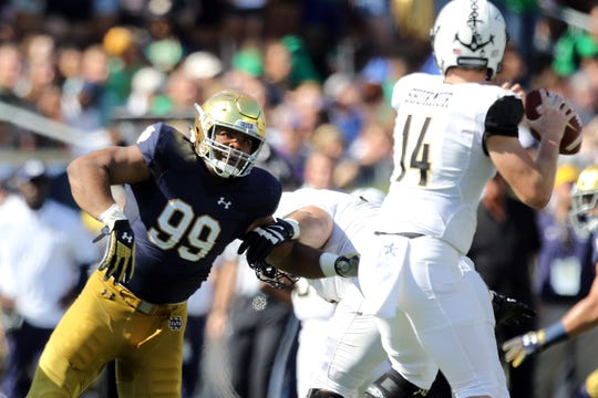 Notre Dame Fighting Irish defensive lineman Jerry Tillery (99) rushes Vanderbilt Commodores quarterback Kyle Shurmur (14) in game between the Notre Dame Fighting Irish and the Vanderbilt Commodores at Notre Dame Stadium in South Bend, Ind., on Saturday, Sept. 15, 2018. Notre Dame Fighting Irish defeats Vanderbilt Commodores 22-17.