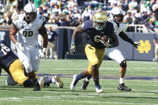 Notre Dame Fighting Irish running back Tony Jones Jr. (6)  runs for a first down in game between the Notre Dame Fighting Irish and the Vanderbilt Commodores at Notre Dame Stadium in South Bend, Ind., on Saturday, Sept. 15, 2018. Notre Dame Fighting Irish defeats Vanderbilt Commodores 22-17.