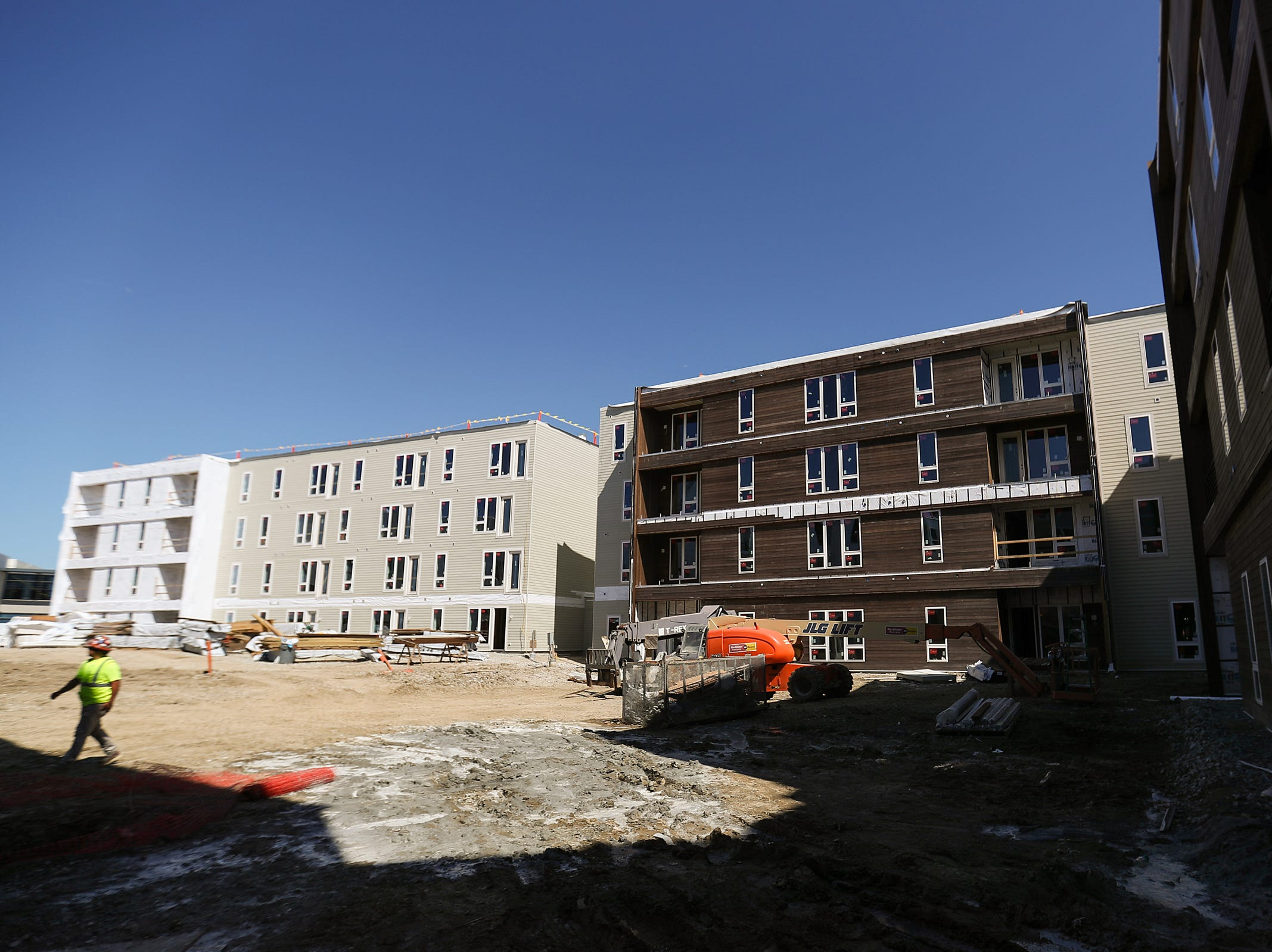 A mid-construction outdoor common area that will house TVs, fire pits, seating and more at the Spark Apartments in Fishers, Ind., is seen on Friday, Sept. 14, 2018. The apartments, at North Street and Lantern road, will 200 offer one-, two- and three-bedroom apartment units and 11 live/work spaces.