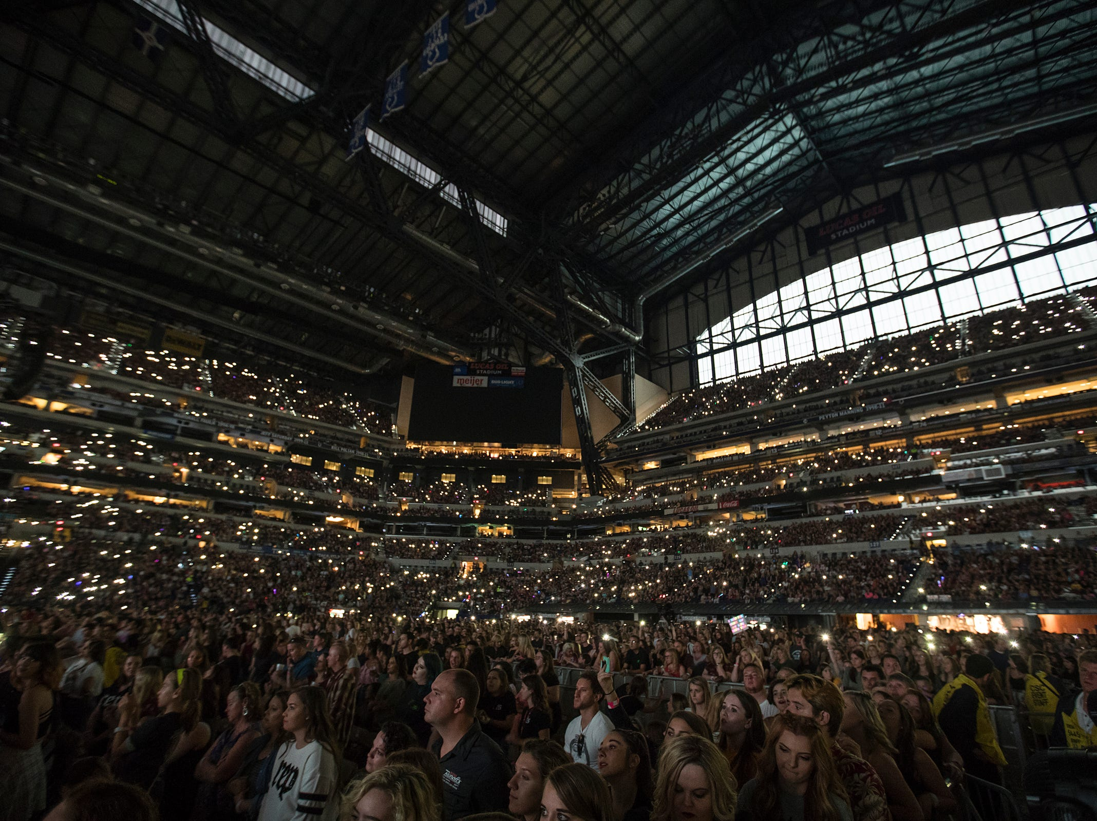 """Fans hold up lights while listening to Camila Cabello, an opening artist for Taylor Swift's """"Reputation"""" tour stop at Lucas Oil Stadium in Indianapolis, Saturday, Sept. 15, 2018. The show is 2018Õs biggest single-day concert in Indianapolis."""