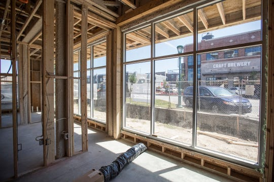 The view from one of 11 live/work spaces at Spark Apartments in Fishers, Ind., looking out at North Street on Friday, Sept. 14, 2018. Each live/work unit combines a studio apartment and storefront retail or commercial space. The complex also offers 200 one-, two- and three-bedroom apartments.
