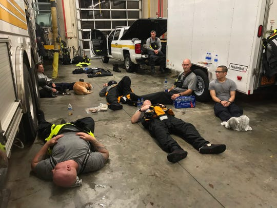 Members of Indiana Task Force take a break after working through the night to rescue people stranded by floods caused by Hurricane Florence.