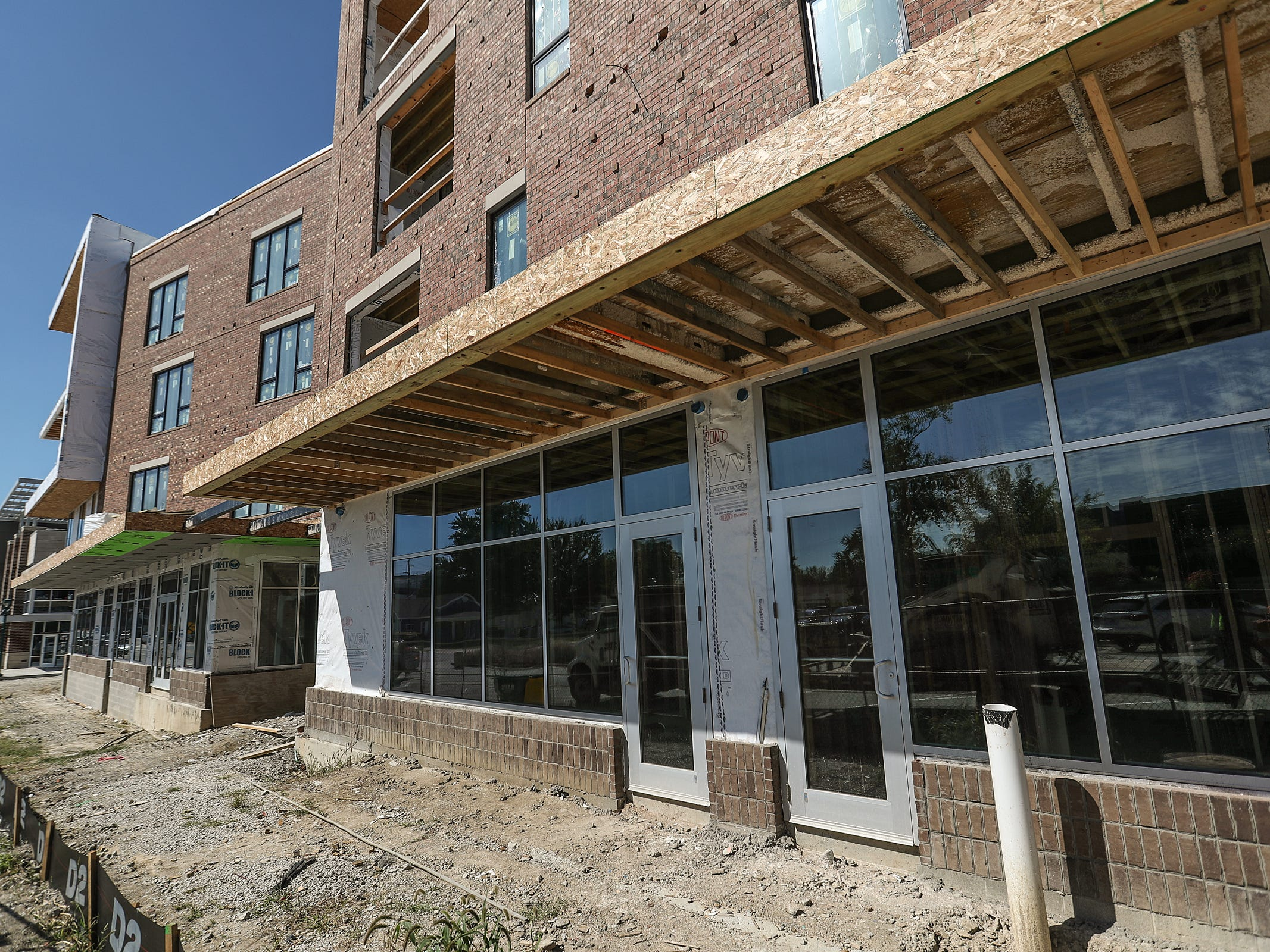Retail space storefronts at Spark Apartments in Fishers, Ind., are seen on Friday, Sept. 14, 2018. The apartments, at North Street and Lantern road, will 200 offer one-, two- and three-bedroom apartment units and 11 live/work spaces, seen here.