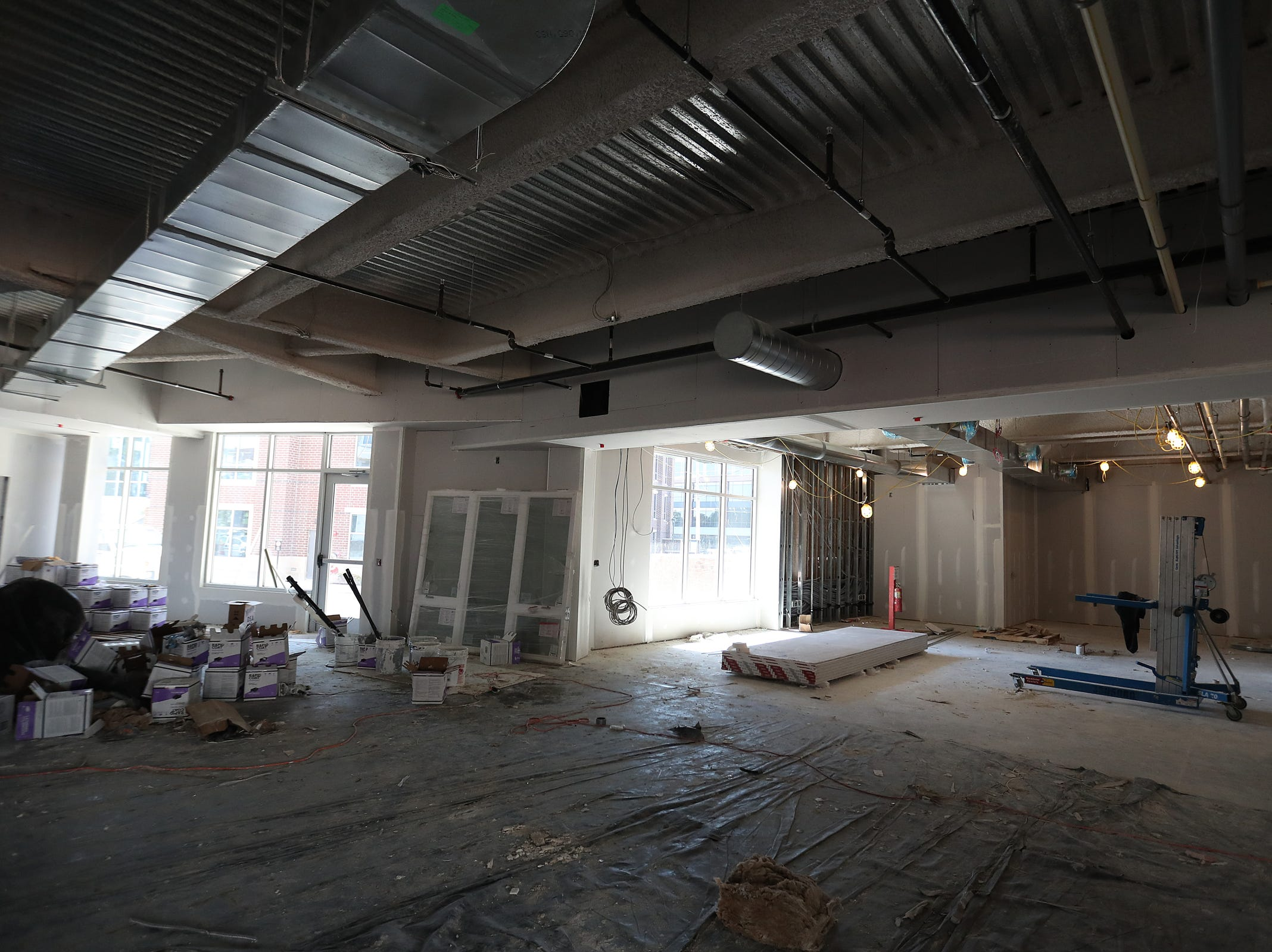 A mid-construction common area that will house a lounge, coffee bar, mail room, fitness rooms, conference rooms and more, in the Spark Apartments in Fishers, Ind., is seen on Friday, Sept. 14, 2018. The apartments, at North Street and Lantern road, will 200 offer one-, two- and three-bedroom apartment units and 11 live/work spaces.