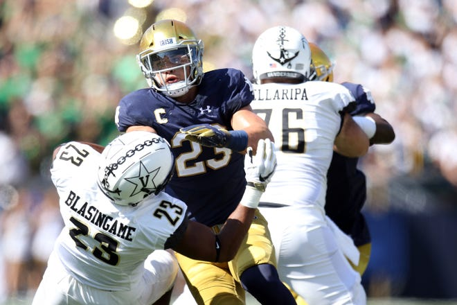 Notre Dame Fighting Irish linebacker Drue Tranquill (23) being blocked by Vanderbilt Commodores running back Khari Blasingame (23) in game between the Notre Dame Fighting Irish and the Vanderbilt Commodores at Notre Dame Stadium in South Bend, Ind., on Saturday, Sept. 15, 2018. Notre Dame Fighting Irish defeats Vanderbilt Commodores 22-17.