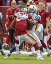 Indianapolis Colts cornerback Kenny Moore (23) stops Washington Redskins running back Chris Thompson (25) on a third-down play during the first half of action. The Indianapolis Colts play the Washington Redskins at FedEx Field in Landover, MD., Sunday, Sept. 16, 2018.