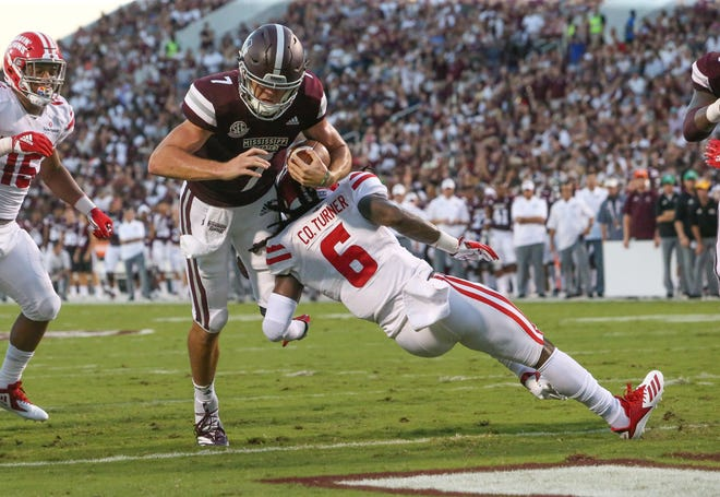 Mississippi State's Nick Fitzgerald (7) scores a touchdown in the first quarter as Louisiana's Corey Turner (6) defends. Mississippi State and Louisiana played in a college football game on Saturday, September 15, 2018, in Starkville. Photo by Keith Warren/Madatory Photo Credit