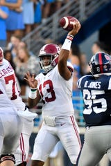 Sep 15, 2018; Oxford, MS, USA; Alabama Crimson Tide quarterback Tua Tagovailoa (13) makes a pass against the Mississippi Rebels during the first quarter at Vaught-Hemingway Stadium. Mandatory Credit: Matt Bush-USA TODAY Sports