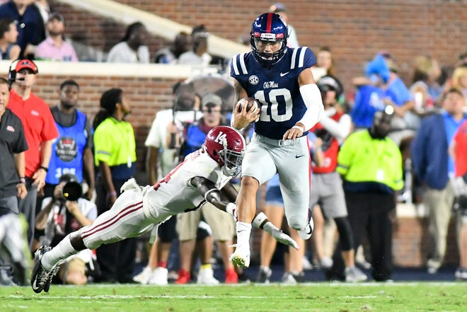Sep 15, 2018; Oxford, MS, USA; Mississippi Rebels quarterback Jordan Ta'amu (10) runs the ball against Alabama Crimson Tide defensive back Deionte Thompson (14) during the second quarter at Vaught-Hemingway Stadium. Mandatory Credit: Matt Bush-USA TODAY Sports