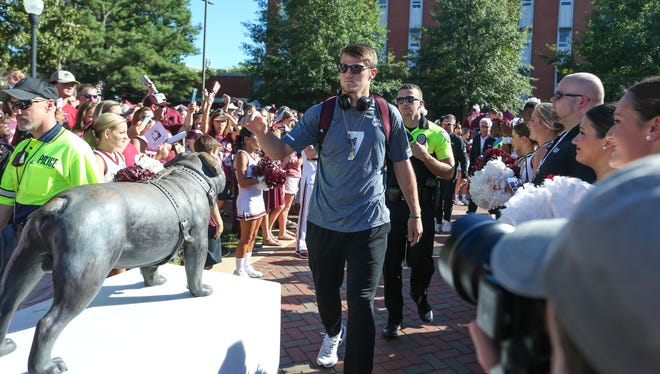 Mississippi State's Nick Fitzgerald (7) touches the Bully statue during Dawg Walk. Mississippi State and Louisiana played in a college football game on Saturday, September 15, 2018, in Starkville. Photo by Keith Warren/Madatory Photo Credit