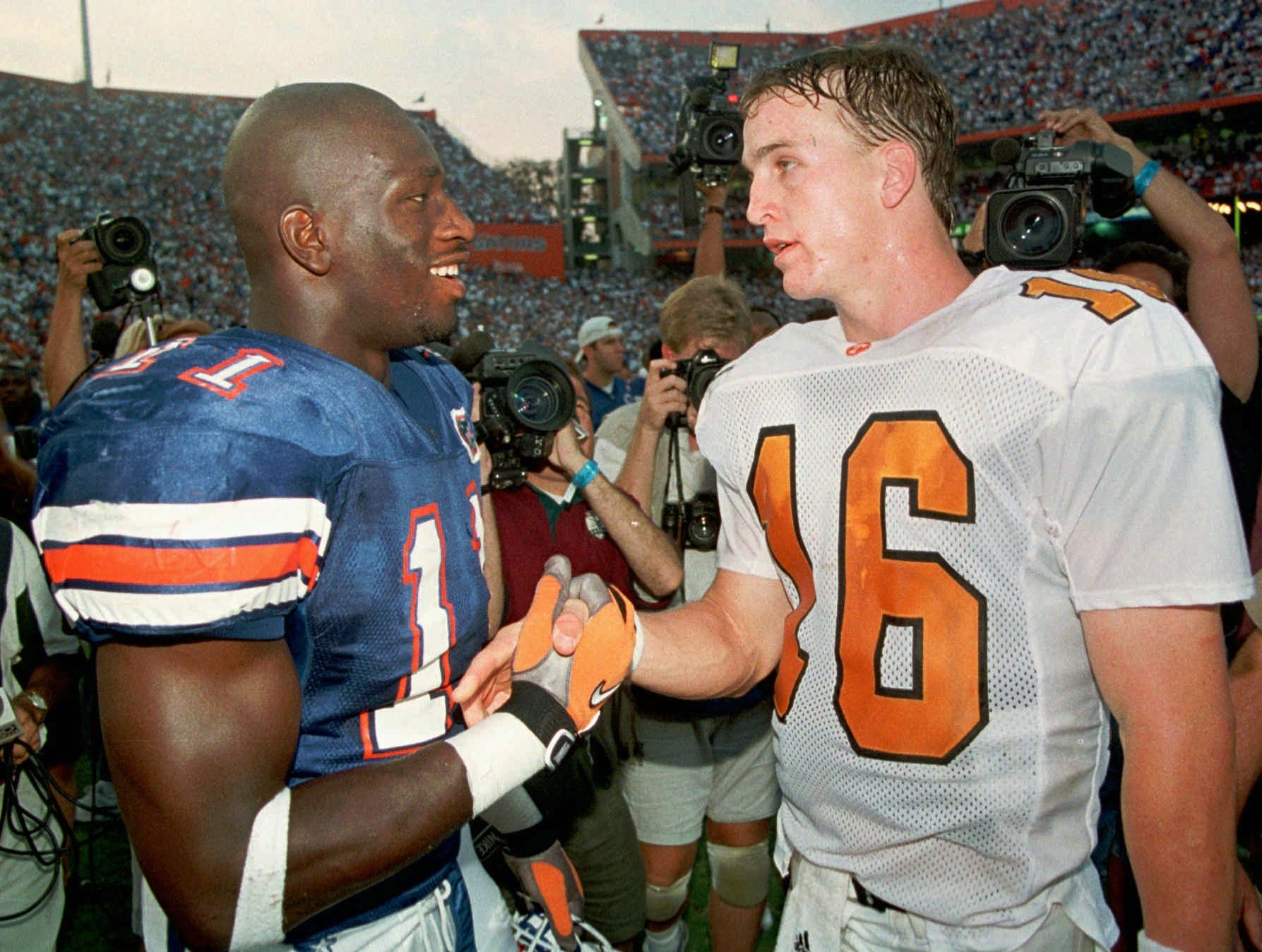 Tennessee quarterback Peyton Manning (16) congratulates Florida defensive end Thaddeus Bullard after the Gators' 33-20 win Saturday, Sept. 20, 1997 in Gainesville, Fla.