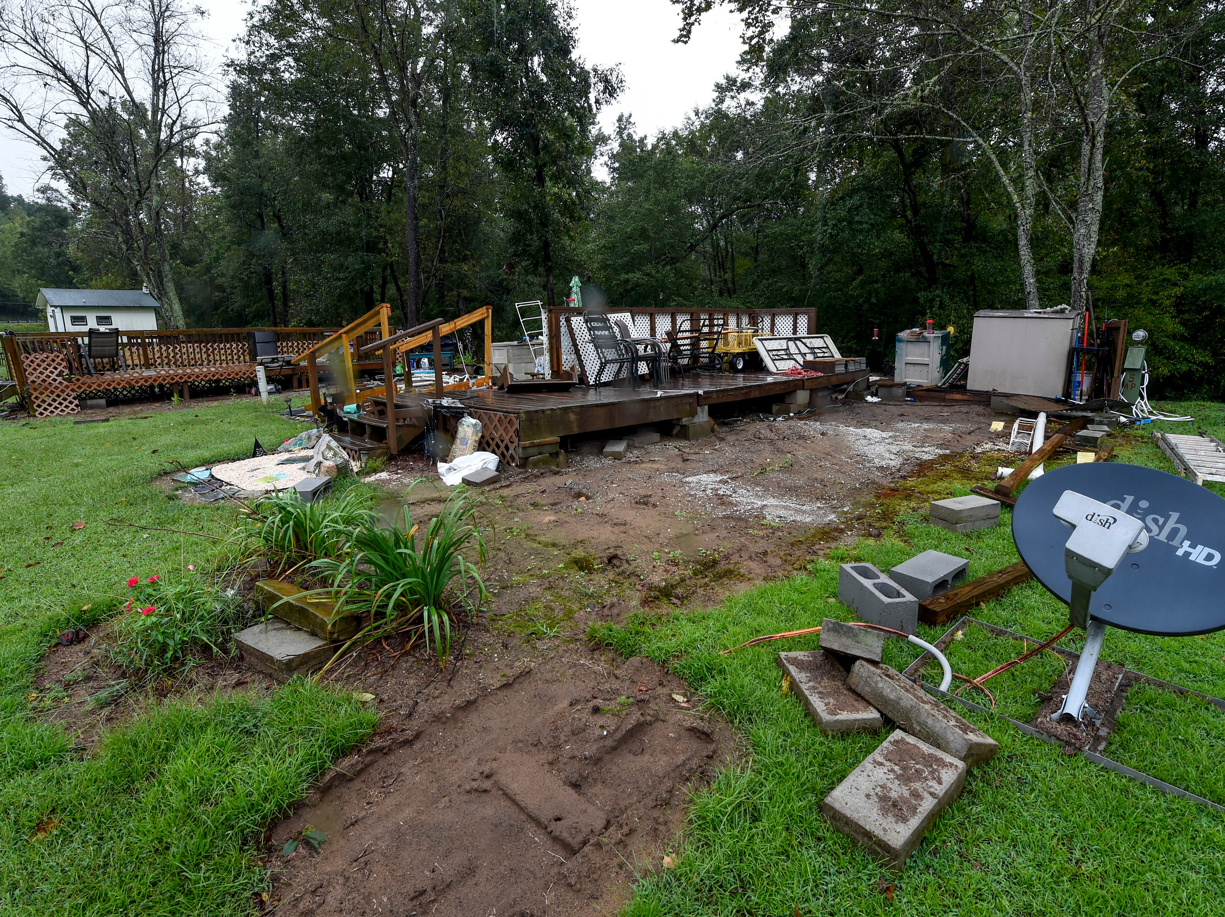 Permanent platforms are empty after their trailers at a park off Route 181 were relocated in anticipation of the adjacent rising water of Steele Creek as a result of the effects of Tropical Storm Florence, Sunday, Sept. 16, 2018 in Morganton, N.C.