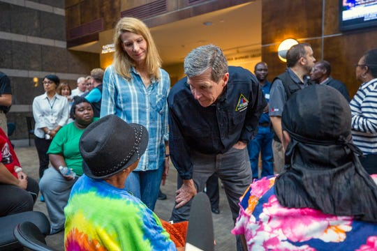 North Carolina Gov. Roy Cooper and first lady Kristin Cooper greet people seeking refuge from Hurricane Florence at a recently-opened shelter operated by the American Red Cross in the Friday Center at UNC-Chapel Hill on Sunday, Sept. 16, 2018, in Chapel Hill, NC. Many of the residents are members of the Congolese refugee community in New Bern, NC, which received a mandatory evacuation order.