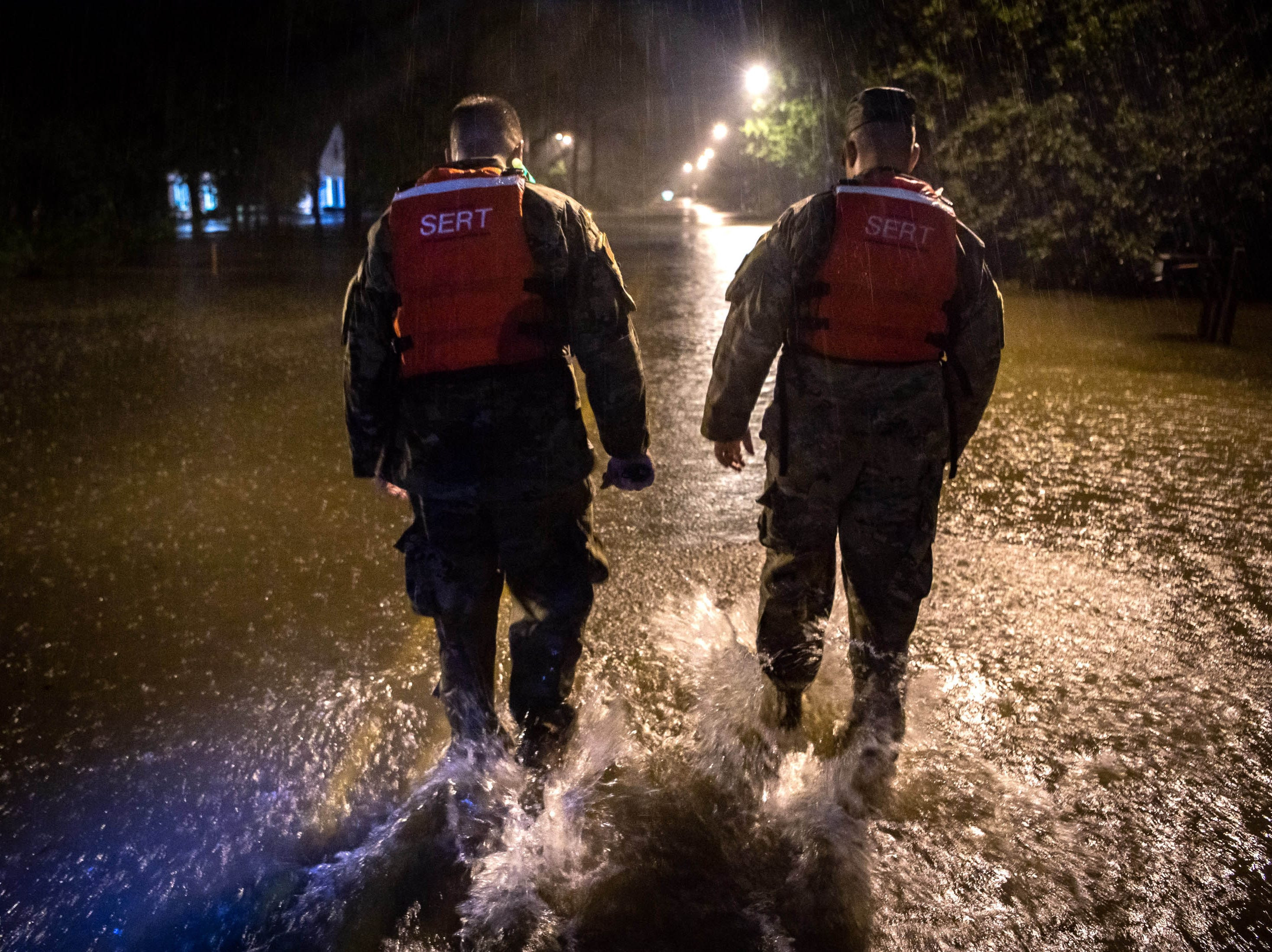 Sep 15, 2018; Lumberton, NC, USA; CSM Sid Baker, left, and 1SG Christopher Jones, right, of the North Carolina National Guard patrol a flooded neighborhood as rain from Tropical Storm Florence continues to fall on Lumberton, N.C., Saturday, Sept. 15, 2018.