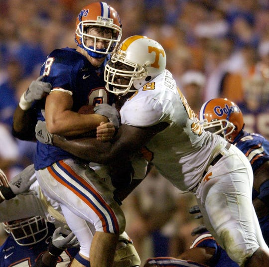 Florida quarterback Rex Grossman (8) is sacked by Tennessee's John Henderson (98) during the third quarter on Saturday, Dec. 1, 2001 in Gainesville, Fla.