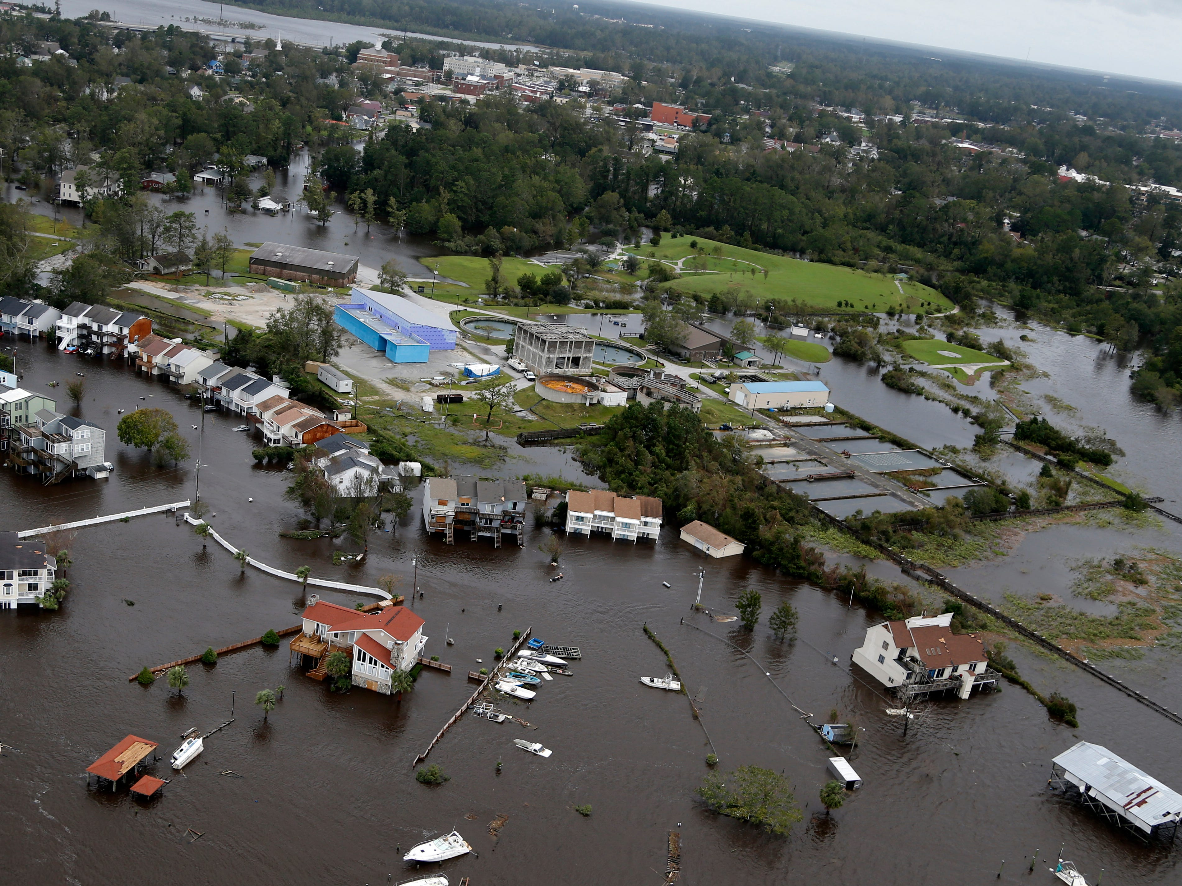 Homes and a marina are flooded as a result of high tides and rain from hurricane Florence which moved through the area in Jacksonville, N.C., Sunday, Sept. 16, 2018.