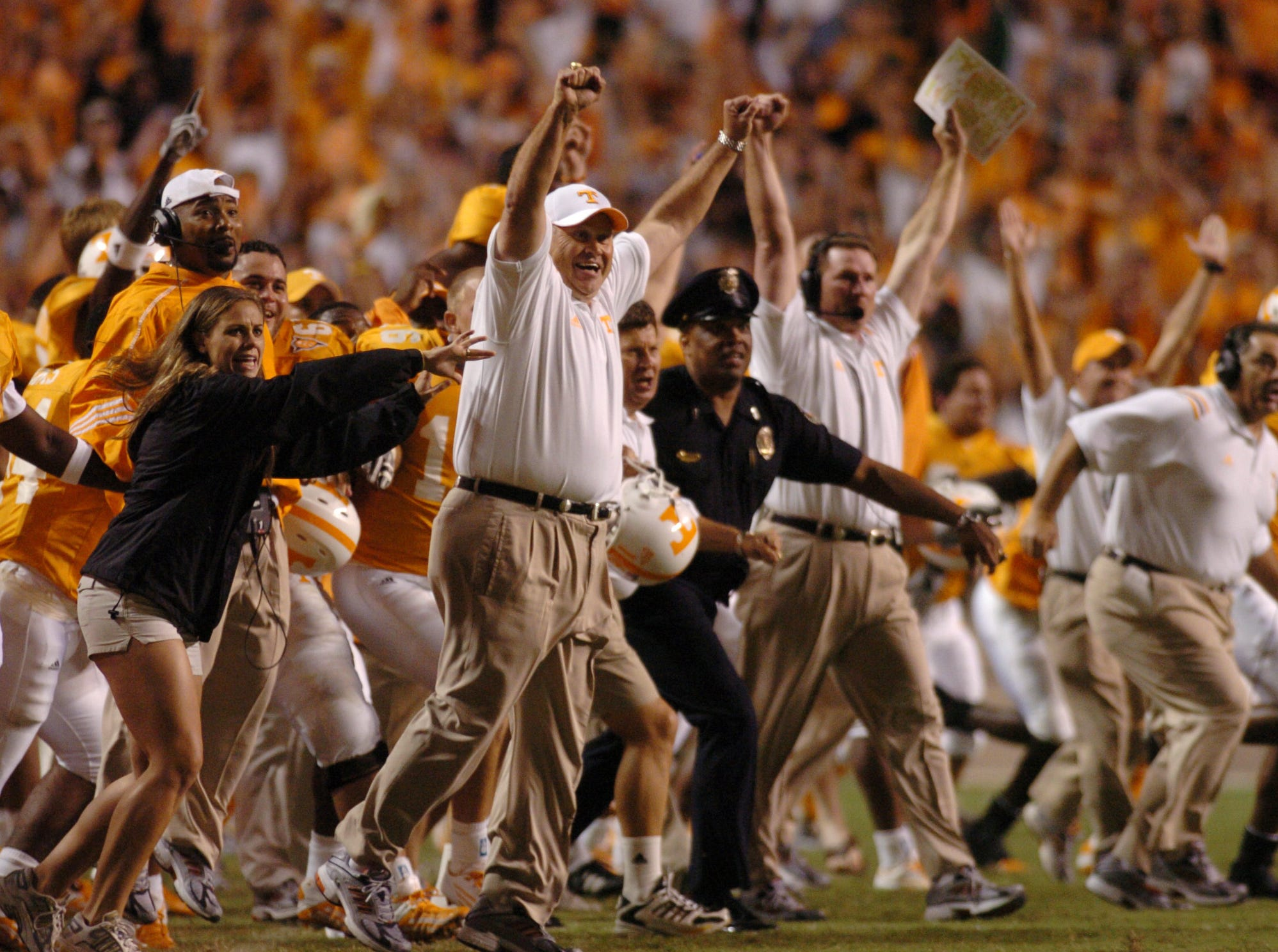 Tennessee's coach Phil Fulmer and the rest of Tennessee's sideline pile onto the field after James Wilhoit's game-winning field goal kick against Florida at Neyland Stadium. 9/18/2004