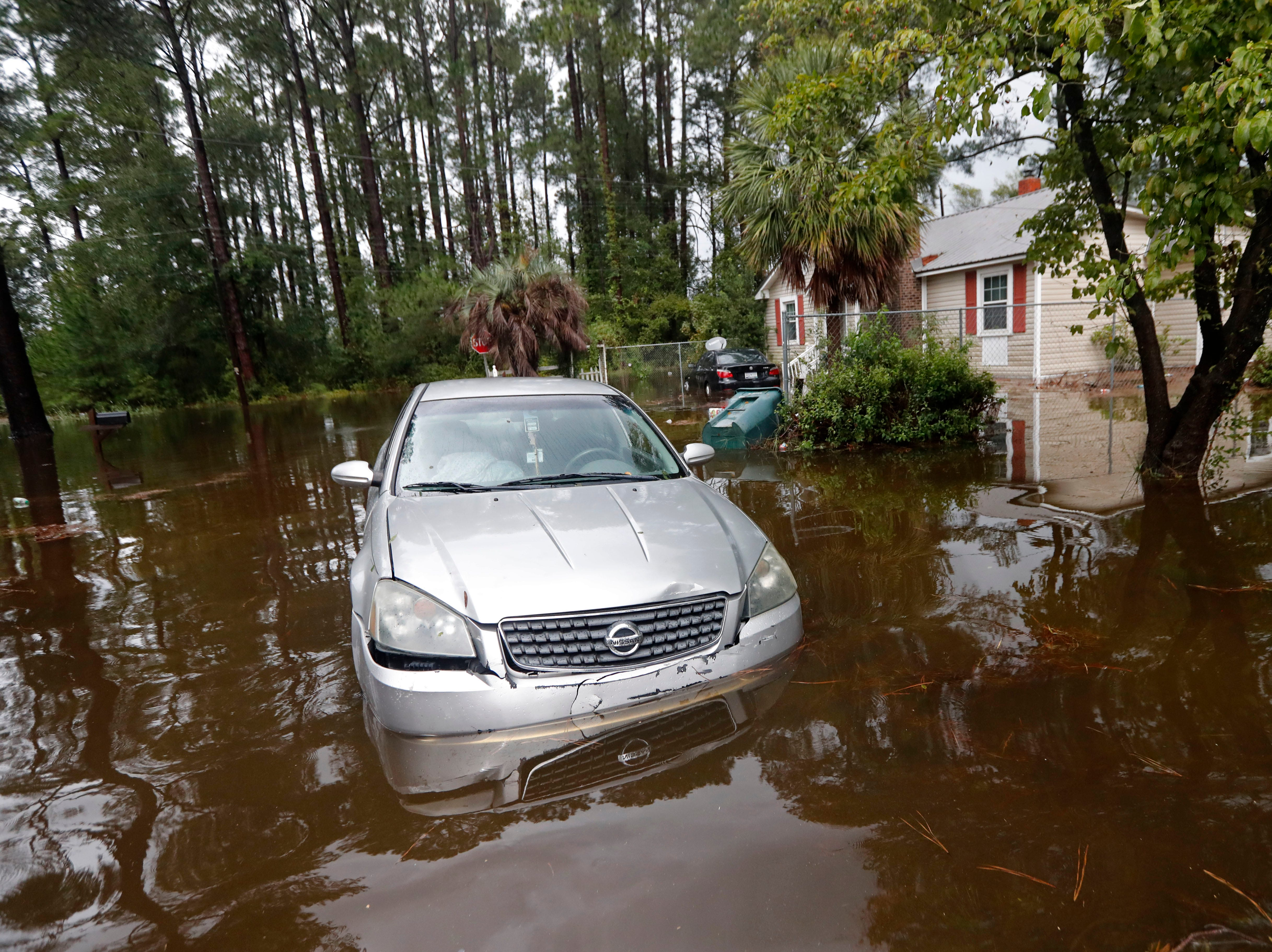 A car sits in floodwaters from Hurricane Florence in Marion, S.C., Sunday, Sept. 16, 2018.