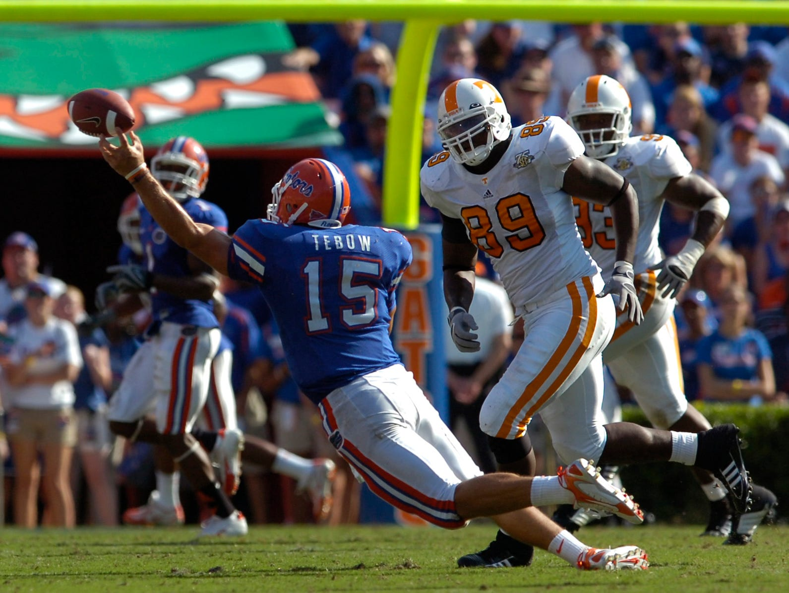 Florida quarterback Tim Tebow throws a complete pass under pressure from the Tennessee defense. Florida won the game 59-20.