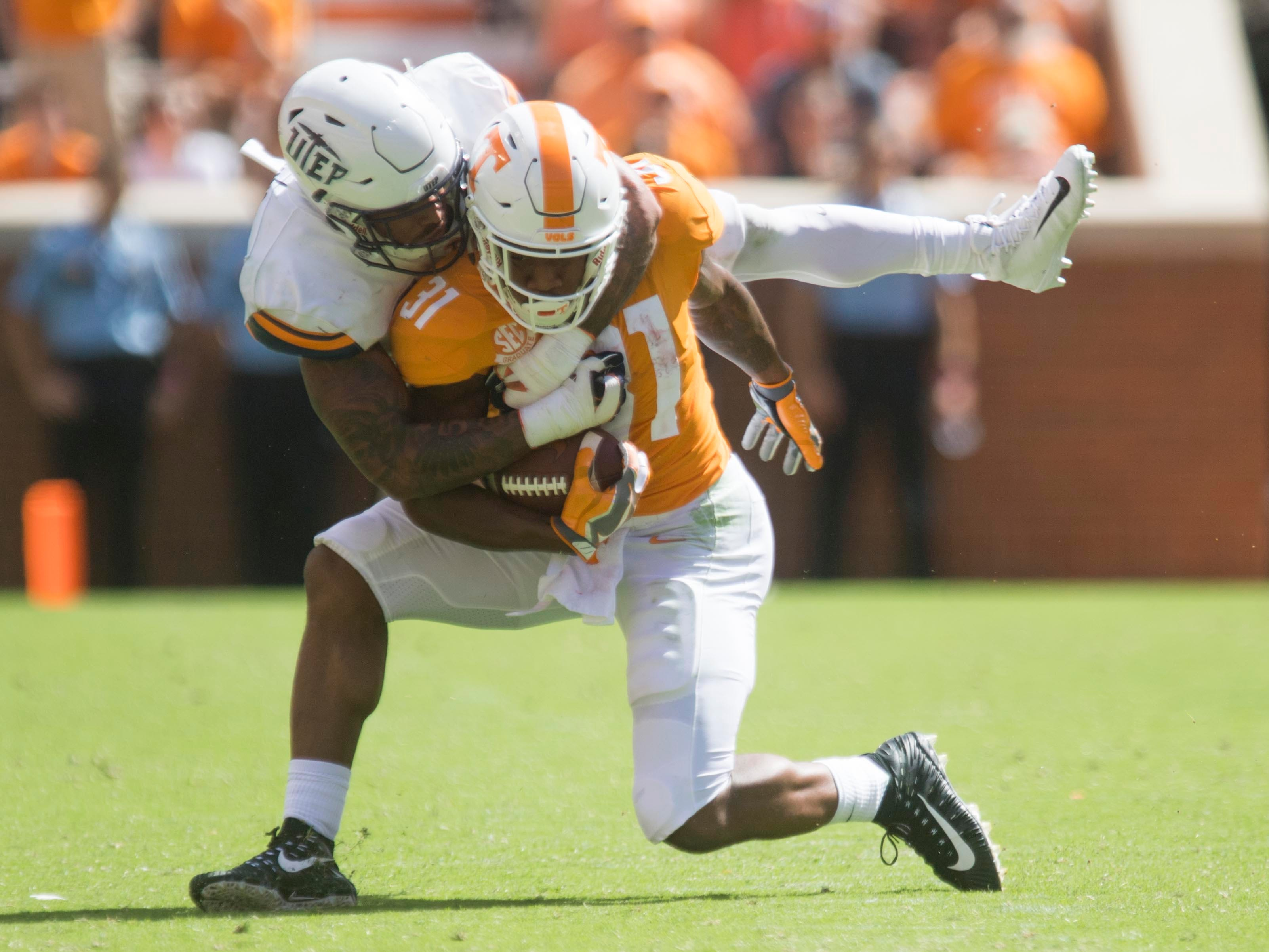 Tennessee running back Madre London (31) is tackled by UTEP linebacker Jayson VanHook (9) on Saturday, September 15, 2018.