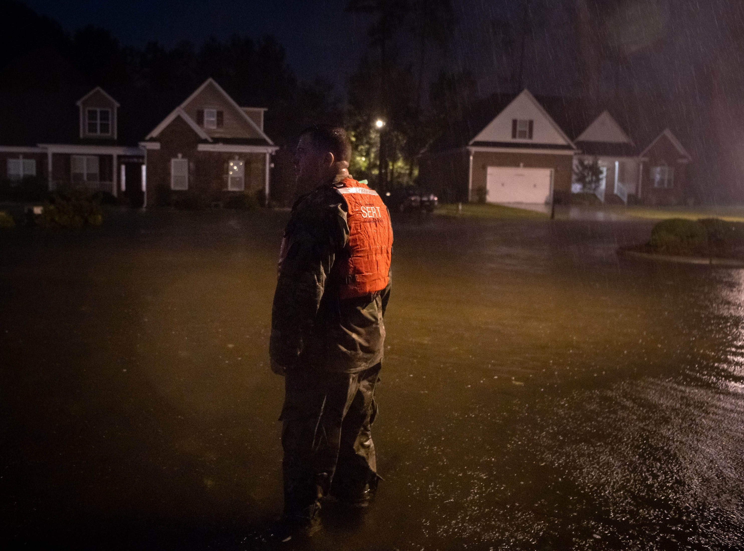 Sep 15, 2018; Lumberton, NC, USA; CSM Sid Baker of the North Carolina National Guard patrols a flooded neighborhood as rain from Tropical Storm Florence continues to fall on Lumberton, N.C., Saturday, Sept. 15, 2018.