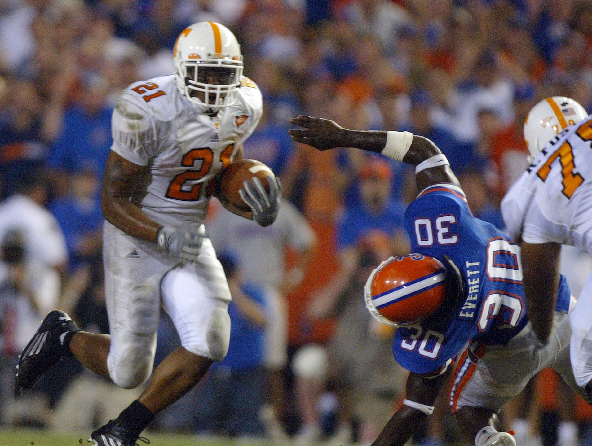 Tennessee's Gerald Riggs Jr. gets past  Florida's  Earl Everett on Saturday in Gainesville.