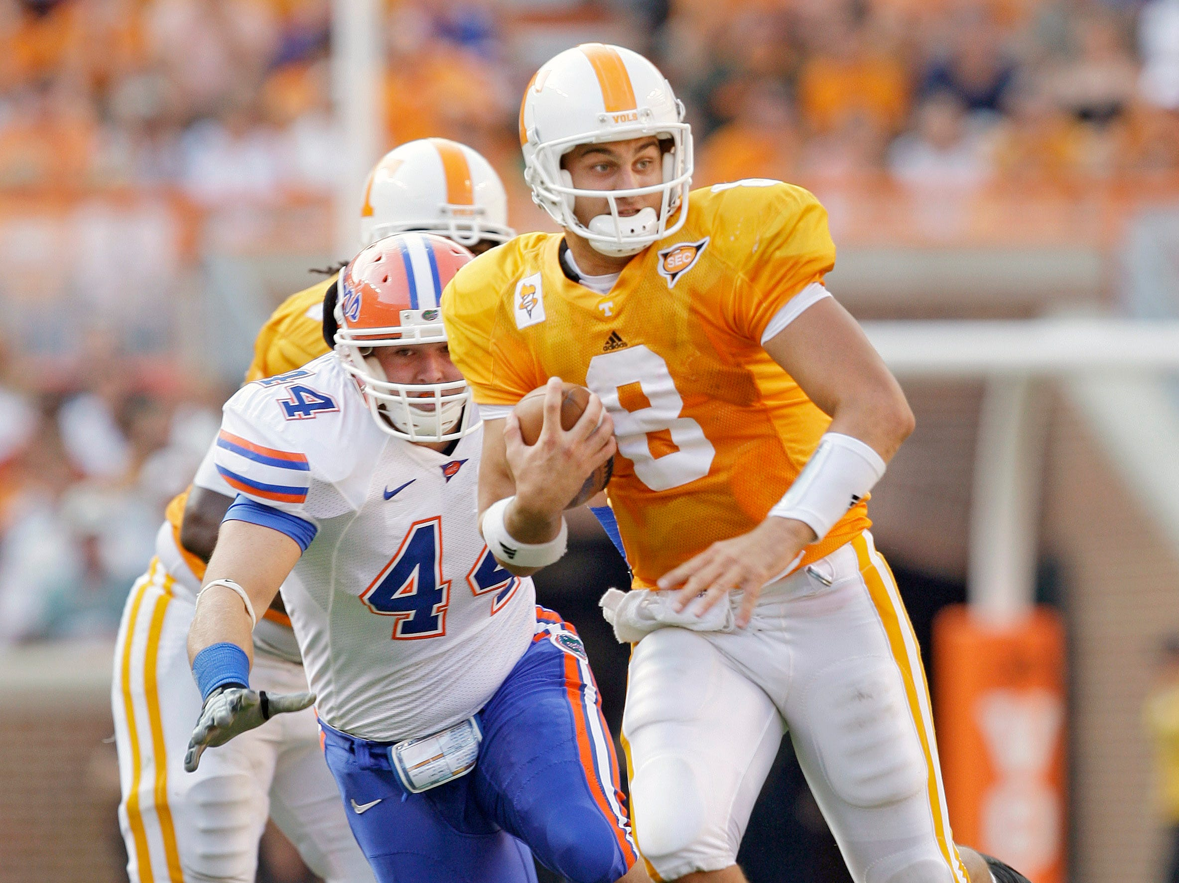 Tennessee quarterback Jonathan Crompton (8) scrambles away from Florida defensive end Duke Lemmens (44) during the third quarter of an NCAA college football game in Knoxville, Tenn., Saturday, Sept. 20, 2008. Florida won 30-6.