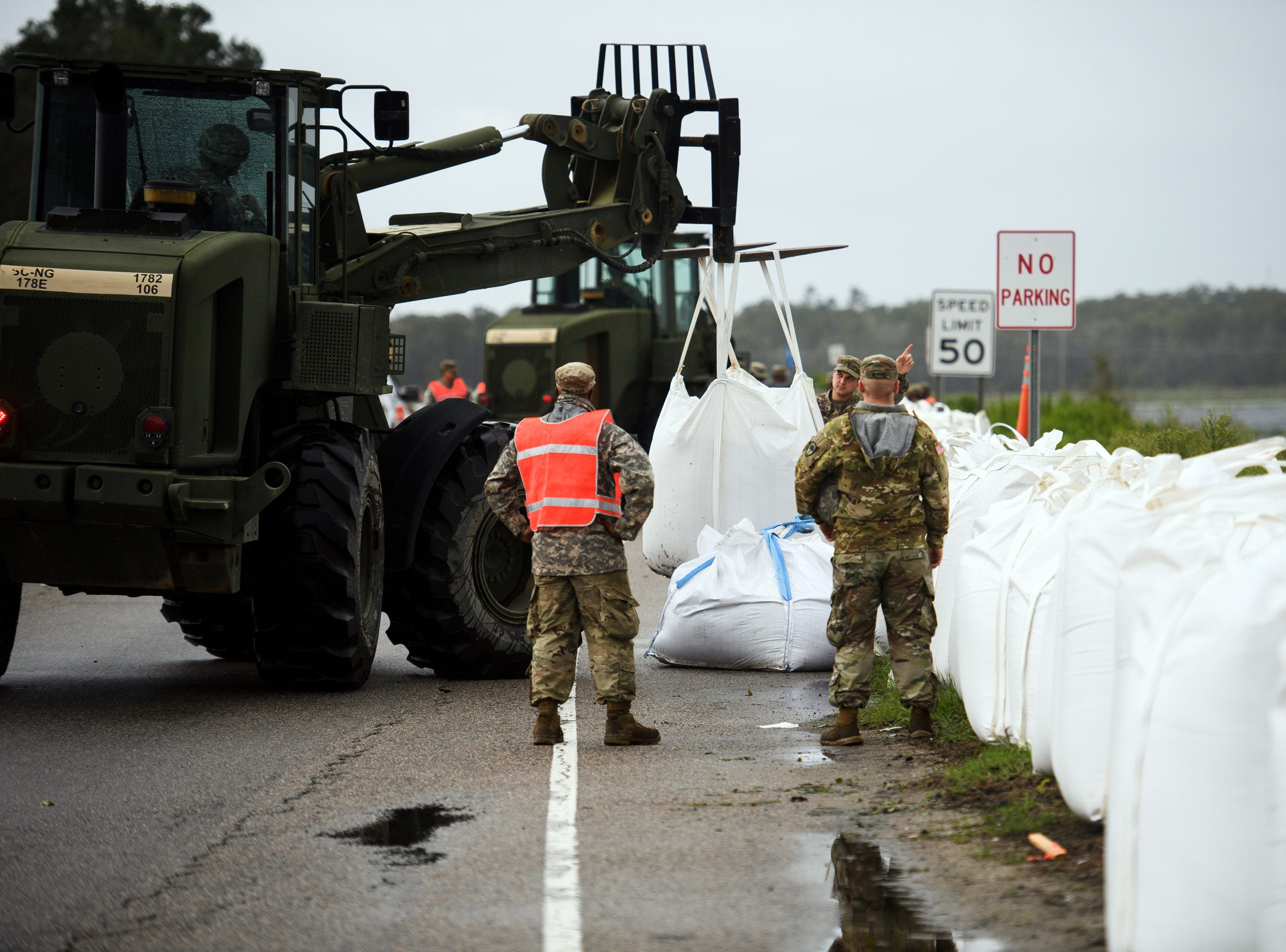 Sept 16, 2018, North Myrtle Beach, SC, Engineering units of the South Carolina Army National Guard lay down sand bags along U.S. 501 South just outside of Conway in preparation of rising water levels on the Waccamaw River due to Tropical Depression Florence on Sunday, Sept. 16, 2018.