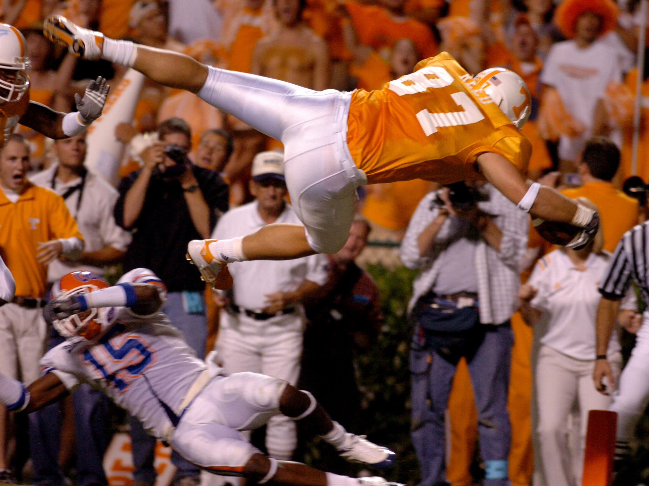 Justin Reed (87) dives into the endzone over the top off Florida's Demetrice Webb during Saturday night's game at Neyland Stadium. 9/18/2004