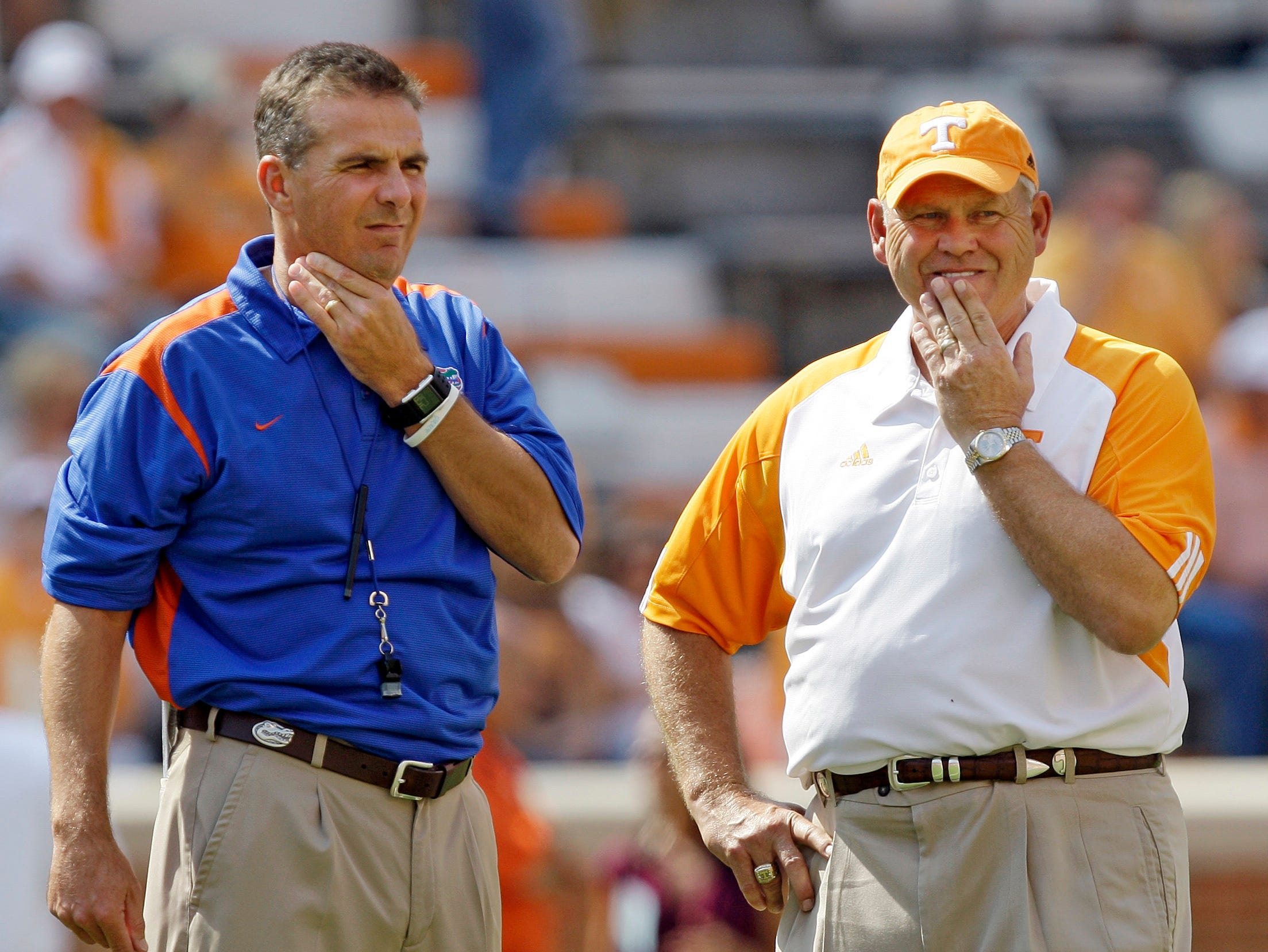 Florida head coach Urban Meyer, left, and Tennessee head coach Phillip Fulmer watch their teams warm up before the start of their NCAA college football game in Knoxville, Tenn., Saturday, Sept. 20, 2008.