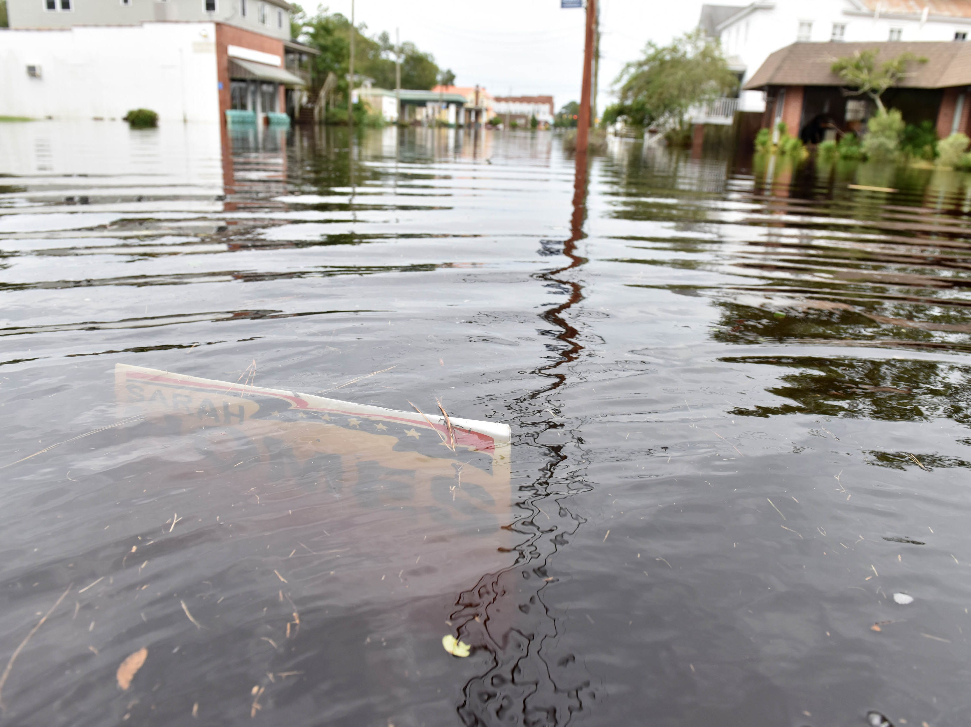 Sep 15, 2018; Belhaven, NC, USA; A campaign sign is under water on Pamlico St in Belhaven, N.C. on Saturday morning on September 15, 2018. Hurricane Florence brought a lot of rain to the area flooding the streets and home.